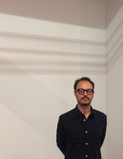 Francisco Ugarte infront of his linear shadow installation, Arrendondo Arozarena, Mexico City